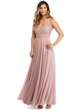 """<p><strong>Special Occasion</strong></p>  <p>Our Katelyn dresswill feel like an absolute dream! She features a V neckline with a wrap style bodice, ruching and shirring along the bust, a hidden back zipper and a flowy A-line skirt.</p>  <p></p>  <p><em>Model is 5'9 with a 32"""" bust, 24"""" waist and 36"""" hips. She is wearing a size small.</em></p>"""