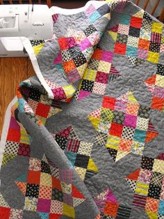 Scrappy Patchy quilt. Made with a 16 patch block and a Road to Oklahoma block.