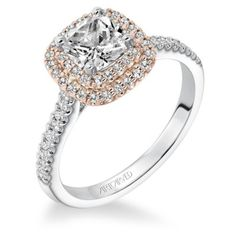 This engagement ring is PERFECT. Love the Cushion diamond and rose gold halo with a white gold band. So pretty!