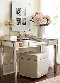 Styled Pretty entry way or wasted space. Mirrored table with ottoman. pink flowers