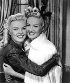 June Haver and Betty Grable, 1945 (swooning over both of their hairstyles).