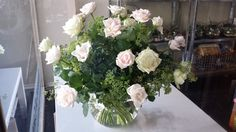 A vintage arrangement featuring soft icy Pinks and White garden roses