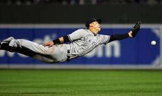 Shallow fly - New York Yankees second baseman Rob Refsnyder dives for a shallow…