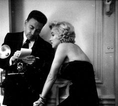 Marilyn with Earl Wilson at a press conference for The Seven Year Itch at the St Regis Hotel in New York, 1954.