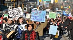 People in Vancouver, Canada, hold a demonstration in support of First Nations, January 11, 2013.