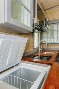 Deep freeze in counter so cool! - 300 Sq Ft Custom Tiny Home on Wheels by Wishbone Tiny Homes 0015 Deep freeze in counter so cool! - 300 Sq Ft Custom Tiny Home on Wheels by Wishbone Tiny Homes 0015 Best Tiny House, Modern Tiny House, Tiny House Living, Tiny House Plans, Tiny House On Wheels, Tiny House Kitchens, Tiny House Interiors, Tiny House Ideas Kitchen, Tiny House Office