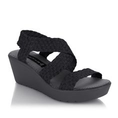 Comfort & style are top on our list when shopping for new sandals! This @stevemadden Bingoo woven wedge sandal is the perfect fit for your active lifestyle.