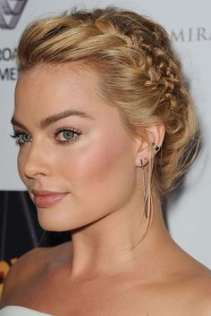 "Margot Robbie "" three braids on the side."""
