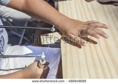 Child learning to work with marquetry saw. Closeup