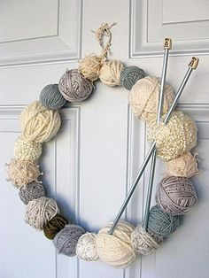 This fun yarn wreath features wintry cream  tones. You could also use red and green for Christmas or bright blue and white for Hanukkah >> http://www.diynetwork.com/decorating/10-unique-ways-to-decorate-your-front-door-for-the-holidays/pictures/index.html?soc=hpp#