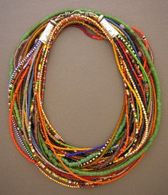 Dorje Designs | This colorful 16-strand necklace is made of thousands of tiny antique  beads from a Fulani woman's waist belt. The Fulani are a nomadic tribe  from Mali, and these belts were typically worn under the women's  skirts.