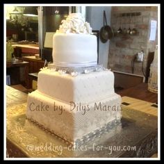 "Wedding cake by Dilys Marais ""I would not have had the confidence to do this had I not read your e-book Lorelie Thank you ""    It is Lorelie's superb carrot cake with pineapple and coconut mousse filling with a white chocolate ganache crumb coat and fondant. ""  ~Dilys Marais~  Western Cape, South Africa"