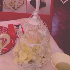 Birdcage with church candle & hydrangeas - vintage
