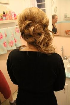 side updo with the hair falling to one side. this reminds me of Belle from Beauty and the Beast. perfection.