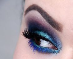 Daring and dramatic this look by Silberschatz is sure to turn some heads! Products used: Makeup Geek Drama Queen, Envy, Nautica, Razzleberry, and Ocean Breeze eyeshadows!