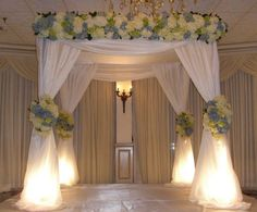 Lights under 4 corners...kinda nice    My Photo Album Wedding Ceremony Photos on WeddingWire