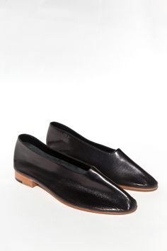 The shoe that defined Martiniano, these slip on flats with rounded toe are soft and minimal, allowing the ...