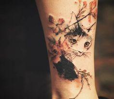 Cat in a flower garden tattoo by Tattooer Nadi