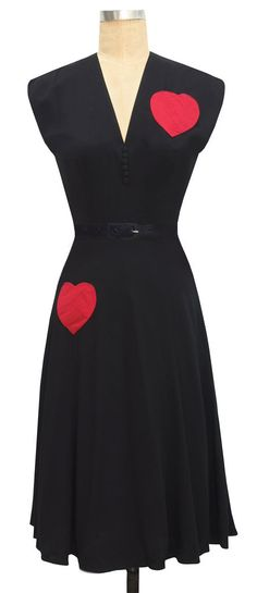 The Trashy Diva Sadie Bustle Dress has two adorable heart shaped pockets on the front and a contrasting red bustle in the back!