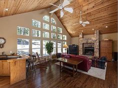 I don't like the continuous run of cedar ceiling trim: nor the odd collection of windows, too busy.