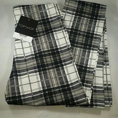 Price Drop! Plaid Topshop Leggings Brand new with tags. Topshop Leggins. Black and white plaid. They are a size 0, but they are very tiny! Topshop Pants Leggings