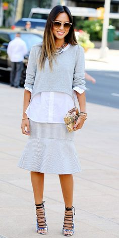 Aimme Song wears gray sweater and midi skirt during New York Fashion Week Sept. 2014