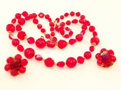 Beautiful 1940's German made dem,i necklace and earring set. Stunning red!