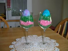 Fill wine glasses with Easter grass and nestle a colored egg into the top to add to each place setting at your dinner table. You can individualize with names on each egg also! At Christmas time I decorate my dining room hutch by adding green paper grass to wine and champagne glasses...let the grass spill over the edge, and place a red ball on top...so pretty!