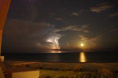 Moonset with stars and lightning. Photo: Marc-André Besel, via NASA.