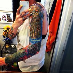 Doctor Who sleeve tattoo.  I would never but omg how cool is that!
