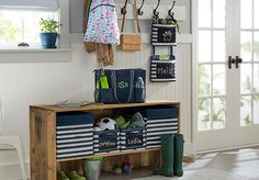 Create a clutter-free first impression with an entryway that doubles as a drop zone.