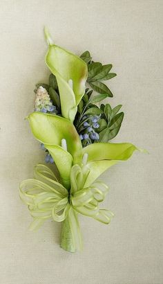 DIY Boutonniere.  You can make this beautiful green boutonniere on your own, or add a wristlet and create a simple corsage.