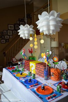 Mario Party Table Setting: How much fun is this?!  And I love the artichoke pendants!