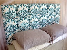 Individual upholstered squares lined up to make a tufted DIY headboard! (Reality Daydream)