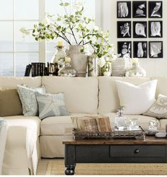 Love the sofa and the display on the sofa table...from Starfish Cottage