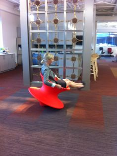 Our employee Cassie taking a spin in Herman Miller's Spun, just in in the new showroom.