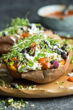 Loaded Sweet Potatoes with Quinoa Tabbouleh. Healthy and totally vegan, these baked sweet potatoes are topped with fresh, vibrant ingredients for a great, satis