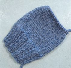 Finished one of a pair of fingerless mittens in wool
