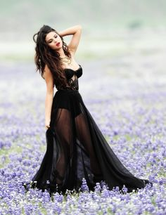 Fashion Beauty. Love the lilies, the look & the dress. Black corset defining the body with delicate black tulle. Lovely!