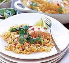 Thai coconut rice with salmon  20g pack of fresh coriander 3 limes 2 x 400ml cans coconut milk 2 tbsp light olive oil 25g butter 2 shallots, finely chopped 90g jar Thai red curry paste (we used Bart's spices) 500g basmati rice 4 kaffir lime leaves, fresh or freeze dried 6 skinless salmon fillets, each weighing about 140g/5oz 3 tbsp soy sauce (we used Kikkoman's) 2 tsp golden caster sugar 4 spring onions 1 plump red chilli, seeded and finely chopped