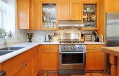 Like the white countertop (quartz) and backsplash with oak cabinets.