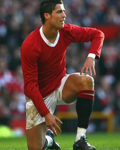Cristiano Ronaldo playing a Manchester United game in tribute to the Busby Babes, in a plain red shirt/jersey