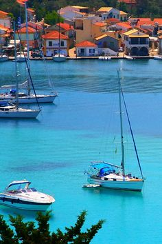 Waterfront with red tiled roofs and boats on blue Mediterranean, Lakka, Paxos island, Ionian, Greece Mykonos, Santorini, Dream Vacations, Vacation Spots, Beautiful Islands, Beautiful Places, Places To Travel, Places To See, Paxos Island