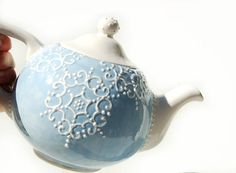 Blue teapot detailed with white accent by Dprintsclayful