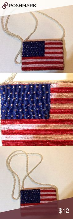 """American Flag beaded purse Cute patriotic bling!  American flag purse made with seed beads, beaded strap, and red satin lining!  6 """" x 4"""".  24.5"""" Strap Drop. Clean - used once! Unbranded Bags Mini Bags"""