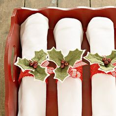 Holly Napkin Rings - Let this handsome holly napkin ring set the tone for a festive table. Wool and velvet felts team with checked ribbon and miniature jingle bells for a classic holiday table setting.