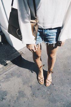 lace up sandals, cut off denim shorts, white loose top with bell sleeves
