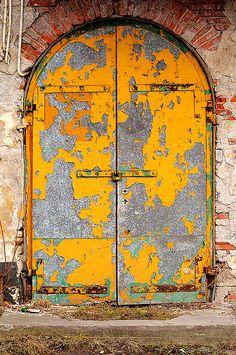Yellow doors showing their age proudly. Les Doors, Windows And Doors, Cool Doors, Unique Doors, Porte Cochere, Door Knockers, Door Knobs, Yellow Doors, Grand Entrance
