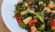 Kale salad recipe with traditional mediterranean flavours plus chickpeas, black beans and tomatoes.