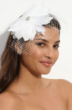 """Tasha 'Birdcage Feather Flower' Fascinator Headband  3.3 out of 5  Feathers, shimmering gems and flirty netting add drama to a satin-covered metal headband.          Approx. flower diameter: 5 1/2""""."""